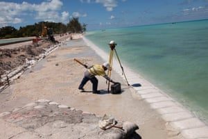 Repairs are done to a causeway linking two of South Tarawa's islands. At high tide the waves can crash over the road.