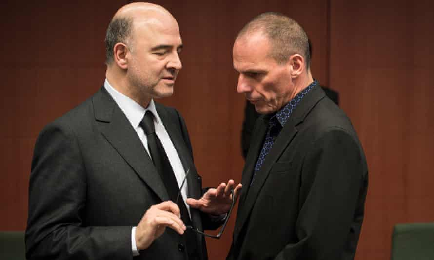 Pierre Moscovici, EU commissioner for economic and financial affairs, talks to the Greek finance minister, Yanis Varoufakis, at a meeting of EU finance ministers.