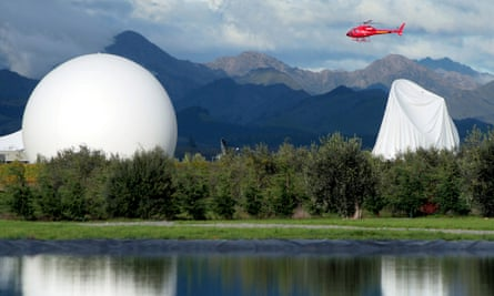 The damaged inflatable cover, right, is seen on the satellite dish at Waihopai Spy Base, after activists deflated the dome in Blenheim, New Zealand, Wednesday, April 30, 2008. A small New Zealand protest group,