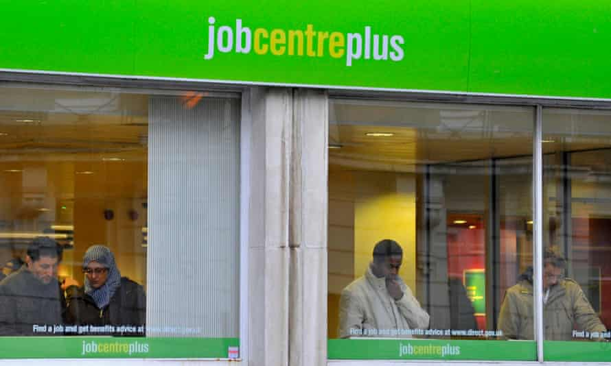 Visitors attend a state Job Centre employment office in central London, December 2011.
