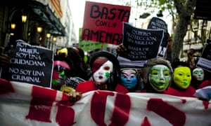 Sex workers wear masks while protesting during an anti-prostitution ban demonstration in Barcelona. A court in the city has gone some way to normalising prostitution by insisting a brothel owner give benefits to its sex workers.