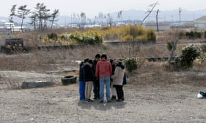 Young people in Miyagi prefecture, northern Japan, offer silent prayers for victims of the 2011 disaster.
