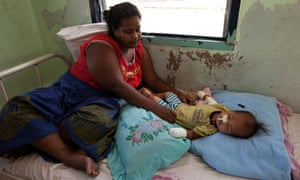 Katewea Atanimatang from Bikenibeu, South Tarawa, looks after her one-year-old baby Atanimatang Atanimatang who is in hospital suffering severe dehydration and malnutrition.