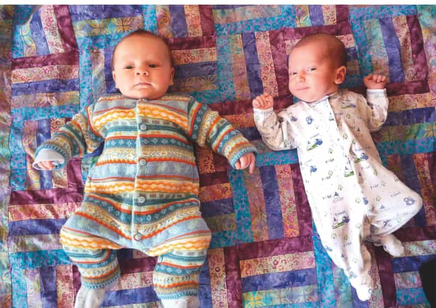 Miranda and Elisa's babies lying on a rug