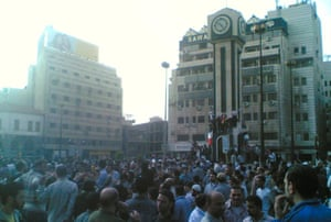 Demonstrators gather in the centre of Homs, April 2011.