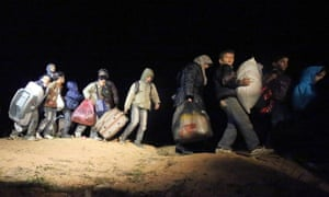 Refugees fleeing the conflict in Syria arrive at the Jordanian border at a safe crossing point.