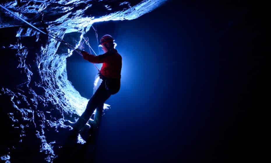A visitor to Zip Below Xtreme uses via ferrata cables deep below Snowdonia