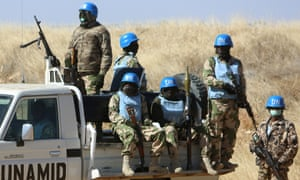 Members of the UN-African Union mission in Darfur (UNAMID) patrol the area near the city of Nyala in Sudan's Darfur on January 12, 2015. Qatar's deputy premier Ahmed bin Abdullah al-Mahmud is on a visit to the war-torn western region of Sudan for the ninth meeting of the committee monitoring the implementation of the Doha Document for Peace Darfur (DDPD).