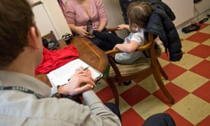 A recently qualified child protection social worker on a home visit .