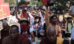 Burmese students shout slogans against a new education bill in Letpadan before a violent police crackdown.