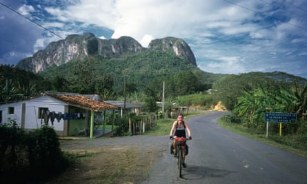 Girl cycle touring in Vinales region of Cuba
