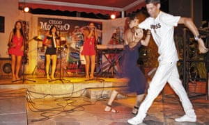 Locals salsa dance to a band in a bar in Varadero.