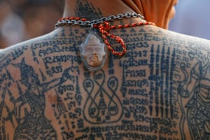 A man with a tattooed body at the annual Magic Tattoo Festival at Wat Bang Phra, Thailand