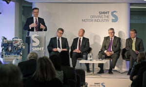 Mike Hawes, left, chief executive of the Society of Motor Manufacturers & Traders (SMMT), speaks as car industry executives, from left, BMW Group UK Managing Director Graeme Grieve, Jaguar Land Rover UK Managing Director Jeremy Hicks, Volkswagen Group UK Managing Director Paul Willis and Ford of Britain Chairman and Managing Director Mark Ovenden, look on during the launch of UK nationwide consumer campaign, promoting diesel technology in central London, March 11, 2015.