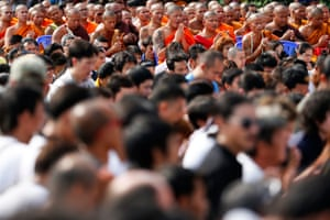 Buddhist monks and devotees pray