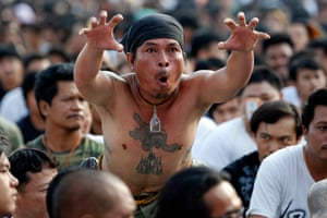 Devotees believe they are possessed by the spirits of the creatures tattooed on their bodies