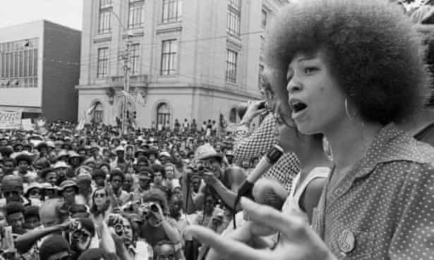 Angela Davis speaks at a street rally in Raleigh