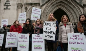 A protest outside the royal courts of justice, London - the court was hearing a legal challenge of the lawfulness of government  changes to legal aid for victims of domestic violence.