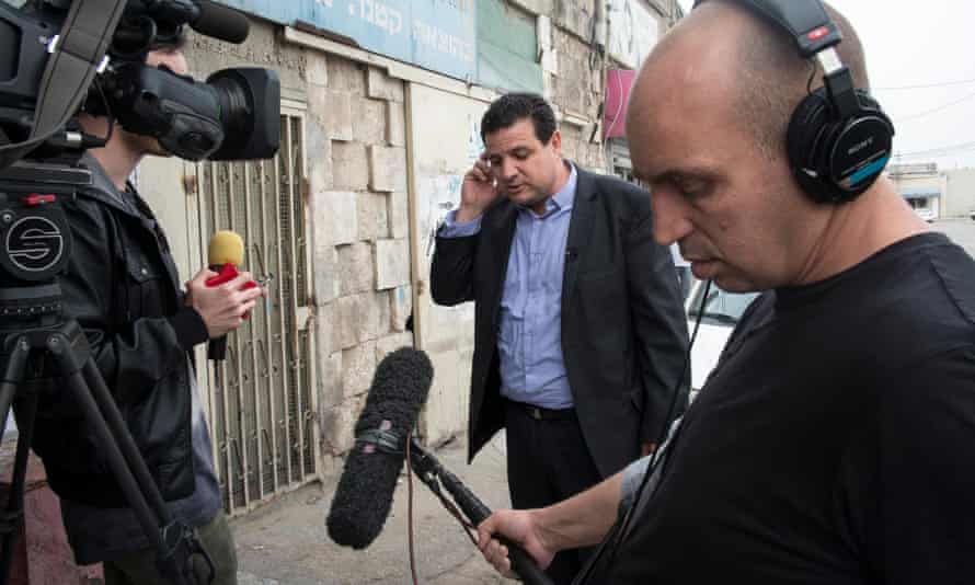 As evidence of the new celebrity status of the leader of the Israeli Arab Joint List, Ayman Odeh fields questions from a television crew in Lod while campaigning about his favourite films and music.