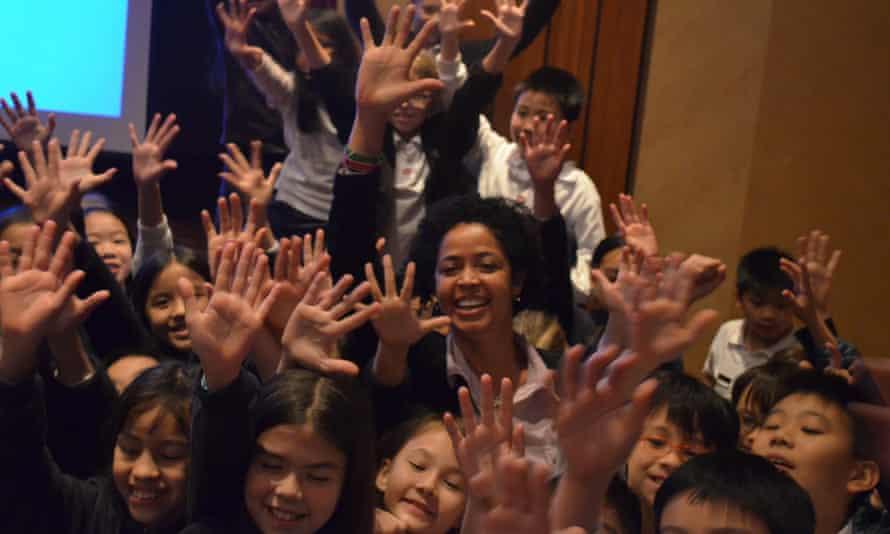 Paula Kahumbu with school children in Hong Kong