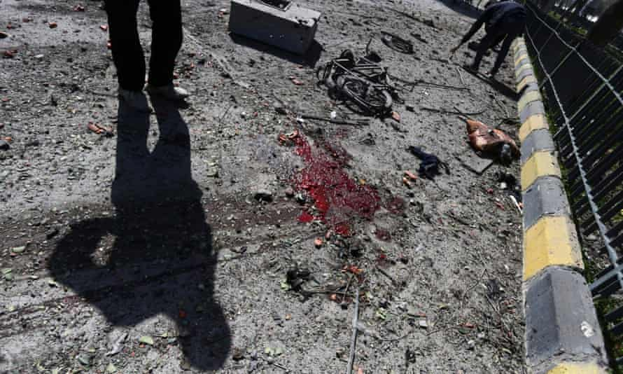 A man stands next to a blood stain in Damascus
