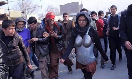 Kubra Khademi was surrounded by a mainly male crowd, which threw insults and stones during her walk.