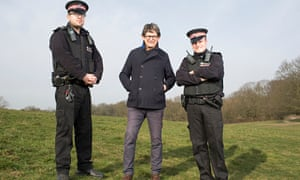 Alan Rusbridger with two police officers