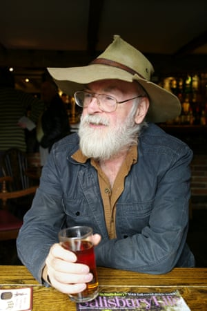 Terry Pratchett enjoys a half pint of Badger Ale in his local pub The Queen's Head, Broad Chalke, Wiltshire, 2012