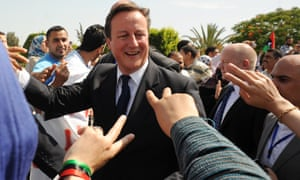 David Cameron visits Libya after the British air strikes.