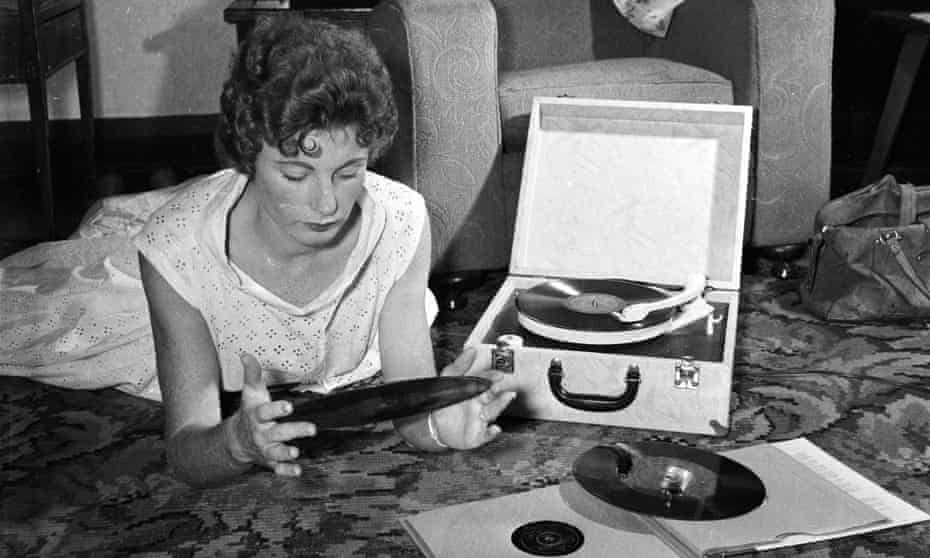 A woman listening to records in 1956