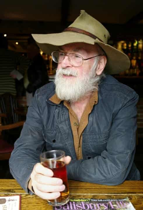 Terry Pratchett enjoys a half pint of Badger Ale in his local pub The Queen's Head, Broad Chalke, Wiltshire, in 2012