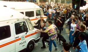 Demonstrators attack police vans during a protest against the poll tax in 1990.