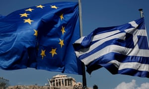 An EU and a Greek flag fly in front of the ancient Parthenon temple, in Athens
