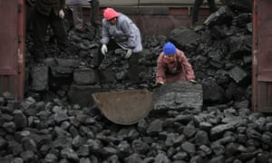 Workers load coal in Tangxian in China's Hebei province. Chinese companies topped a list of owners of the least efficient 'sub-critical' coal power plants globally.