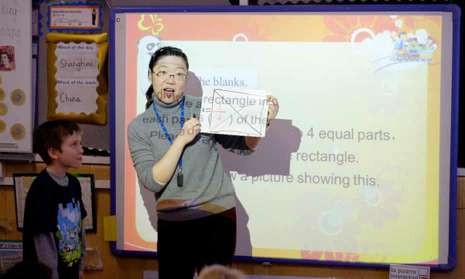 Lianjie Lu, from Shanghai, teaches fractions to year 3 pupils at Fox primary school in Kensington, London.