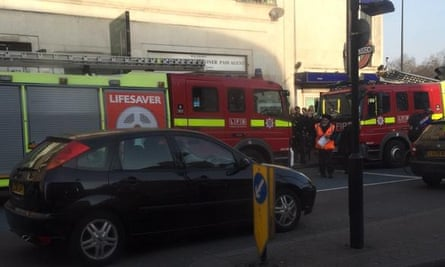 Fire engines outside Clapham South station after a woman fell between the platform and a train.