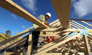 A builder uses a saw as he works on the roof joists of a new residential home during construction at a Bellway Plc real estate site in Northampton, U.K., on Thursday, Oct 10, 2013. U.K. house prices rose to a record last month as easier access to credit drove first-time buyers back to the market, Acadametrics said. Photographer: Chris Ratcliffe/Bloomberg via Getty ImagesEMEA;EUROPE|EAME;EUROPE|UNITEDKINGDOM;UK;U.K.|FINANCE;FINANCIAL;ECONOMY|ECONOMY;ECONOMIC;ECO|BUSINESS;CORPORATION;CORPORAT|CONSTRUCTION;PROPERTY;BUILDIN|HOME;HOMES;HOUSE;HOUSES|REALESTATE;PROPERTY;HOUSING