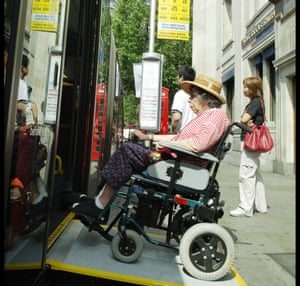 Wheelchair user uses a ramp to board a London bus.