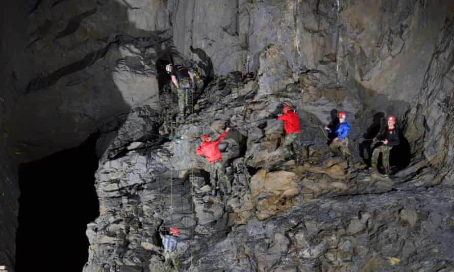A group makes its way along one of the via ferrata sections (hooking on to cables)