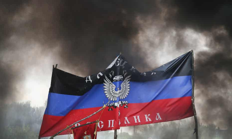 The flag of the self-declared Donetsk People's Republic, following an assault by the Ukrainian army in Kramatovsk, Ukraine.