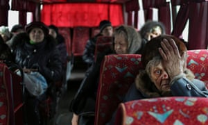 Local citizens sit in a bus as they wait to evacuation from Debaltseve of Donetsk area, 3 February.