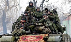 Members of self-proclaimed Donetsk People's Republic drive a tank on the outskirts of Donetsk in January.