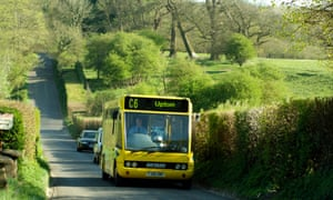 Single deck bus travelling along a country lane in Hampshire