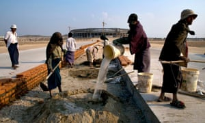 Workers build a road in Naypyidaw.