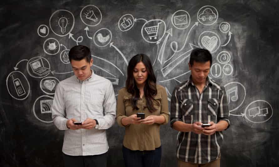 people holding phones with blackboard behind