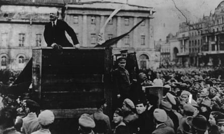 Vladimir Ilyich Lenin addresses a crowd in Moscow after the Russian revolution. Russian activist Leon Trotsky is on the right of the podium.