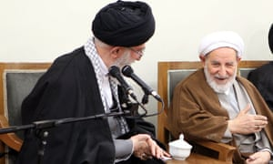 Ayatollah Ali Khamenei (left) speaking to Mohammad Yazdi, chairman of Iran's Assembly of Experts, during a meeting with members of the assembly in Tehran.