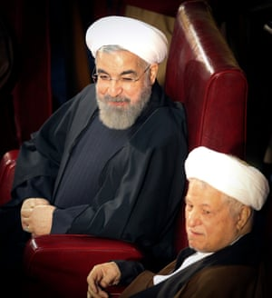 Iranian President Hassan Rouhani (left) and former President Akbar Hashemi-Rafsanjani attend a two-day official meeting of Iran's Assembly of Experts in Tehran, Iran, March 10, 2015.