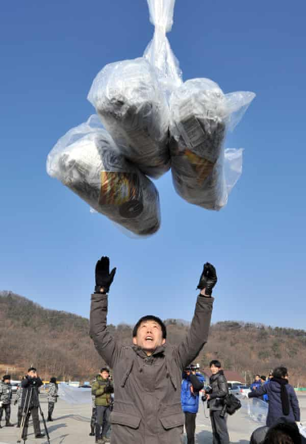 Dissenting voice ... Park Sang-hak, releasing a balloon carrying anti-North Korea leaflets, has been branded 'human scum' by the regime. Photograph: Jung Yeon-je/AFP/Getty Images