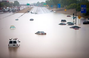 Cars are stuck in flood waters on I-10 east at 43rd Ave. after heavy storms pounded the Phoenix area early Monday, flooding major freeways, prompting several water rescues and setting an all-time single-day record for rainfall in the desert city, 8 September 2014.